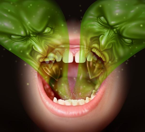 Emberi szájból kijövő két, zöld, fintorgó szörny - utalás a rossz leheletre.