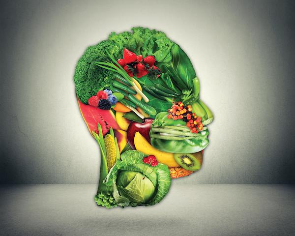 Egy emberi fej formája kirakva gyümölcsökből és zöldségekből.