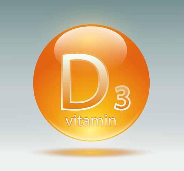 D3-vitamin egy narancssárga körben.