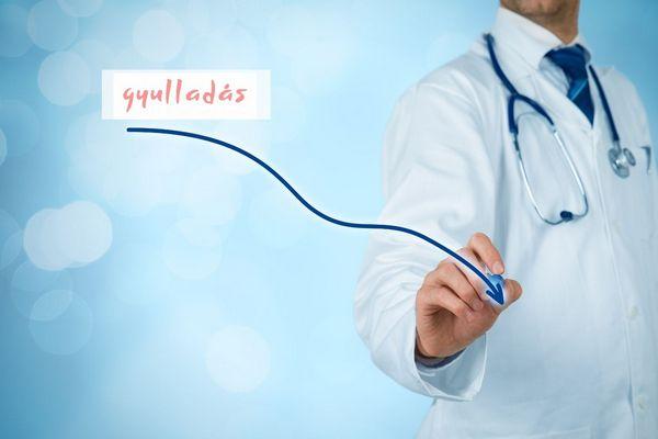 Egy fehér köpenyes orvos a levegőben egy lefelé ívelő csíkot húz, amellyel a gyulladás csökkenését imitálja.