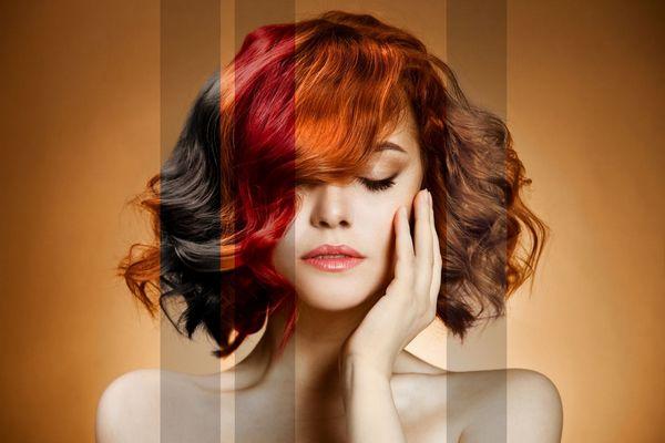 Egy narancs színű háttér előtt fiatal nő vörösre és barnára festett hajjal, kezét az arcához emeli.